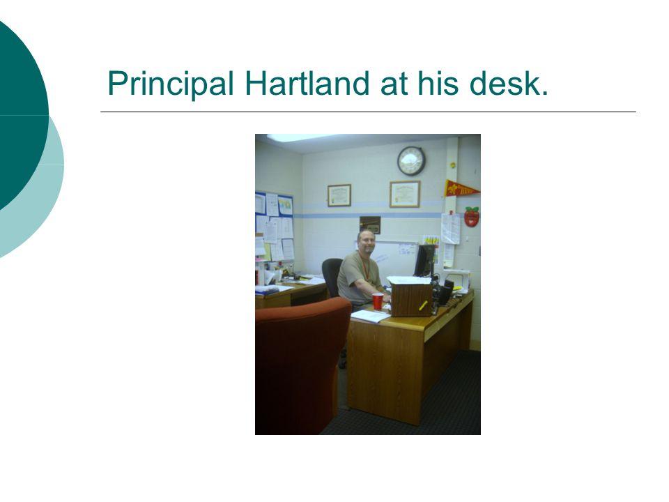 Principal Hartland at his desk.