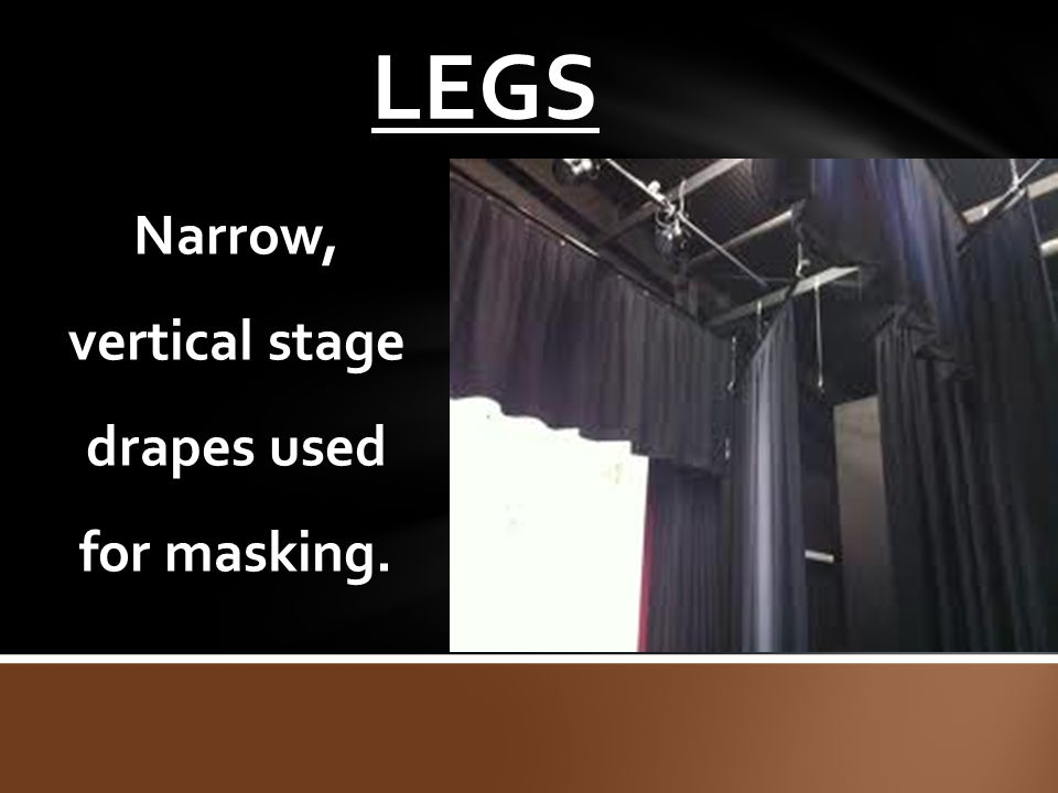 Narrow, vertical stage drapes used for masking.