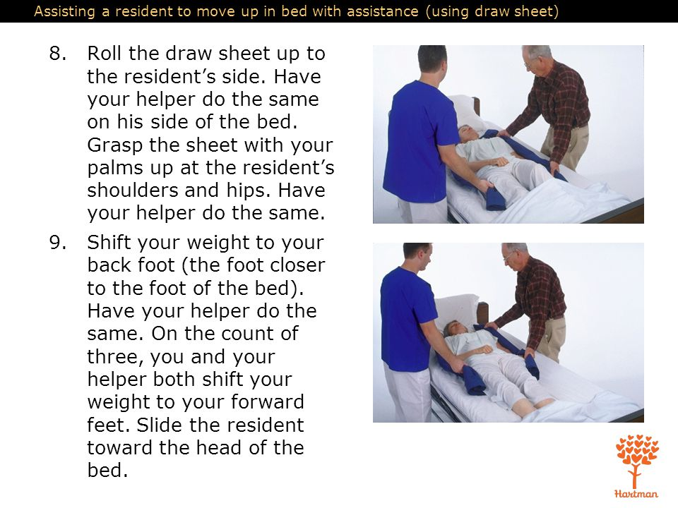 Assisting a resident to move up in bed with assistance (using draw sheet)