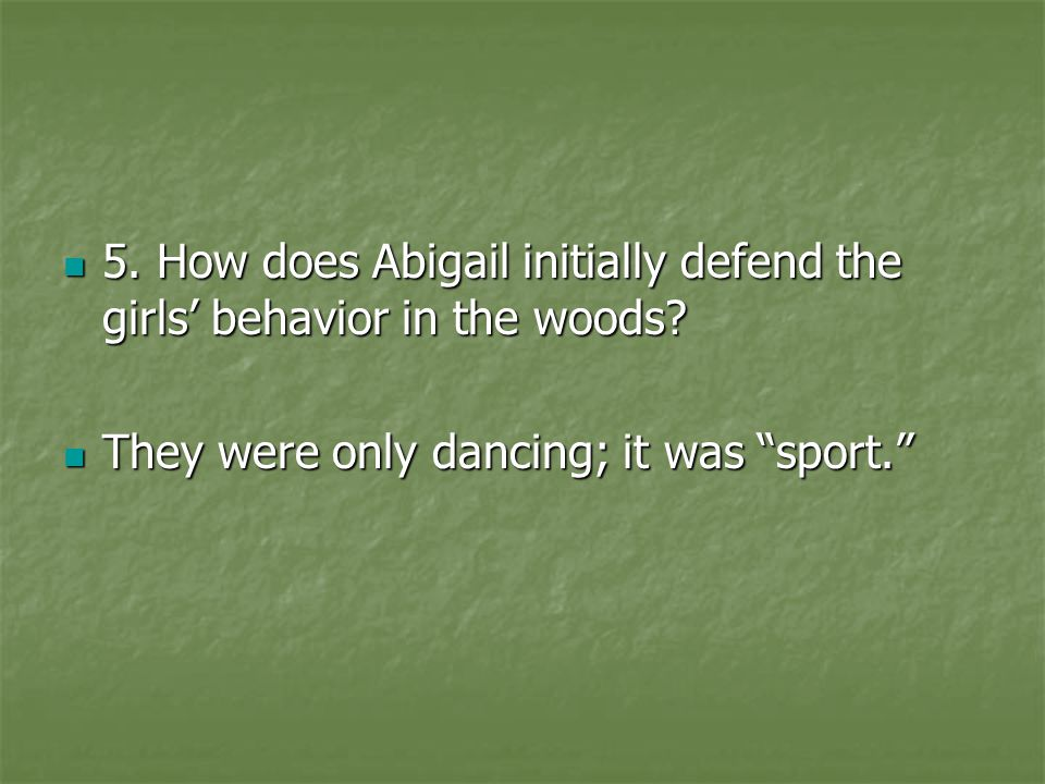 5. How does Abigail initially defend the girls' behavior in the woods