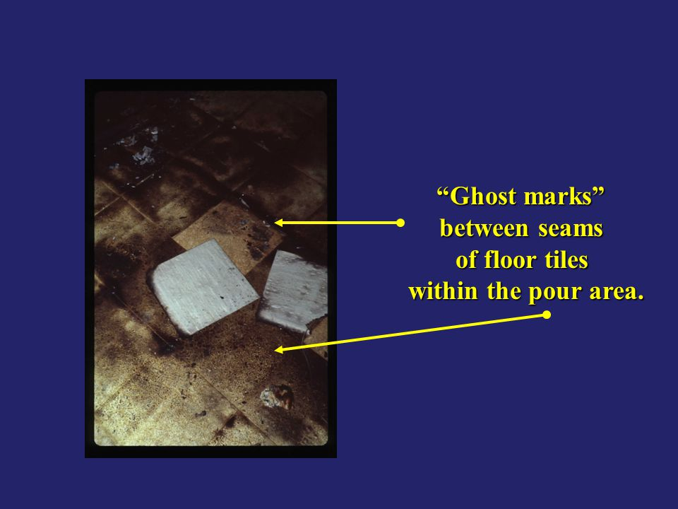 Ghost marks between seams of floor tiles within the pour area.