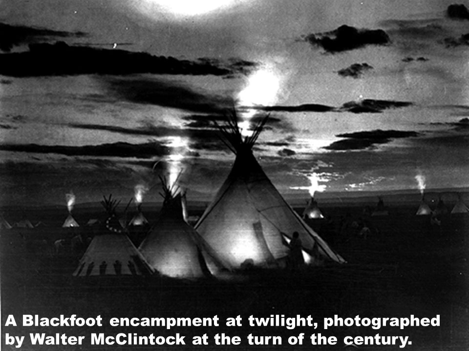 A Blackfoot encampment at twilight, photographed by Walter McClintock at the turn of the century.