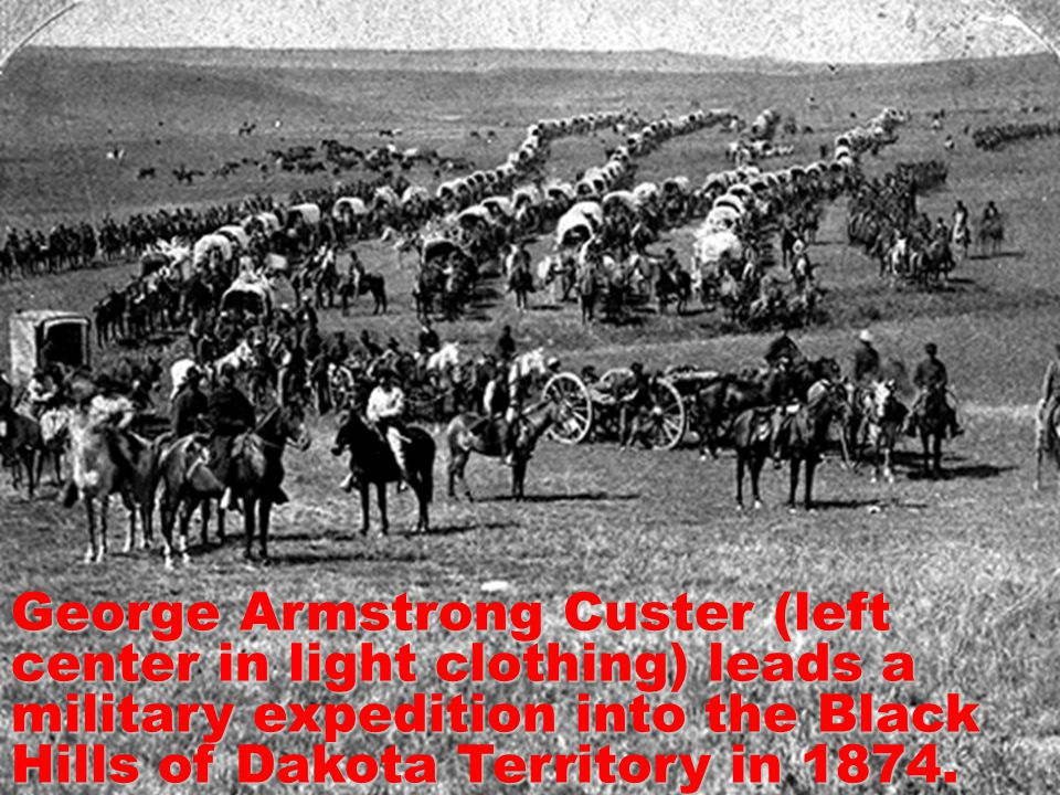 George Armstrong Custer (left center in light clothing) leads a military expedition into the Black Hills of Dakota Territory in 1874.