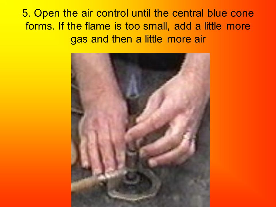 5. Open the air control until the central blue cone forms