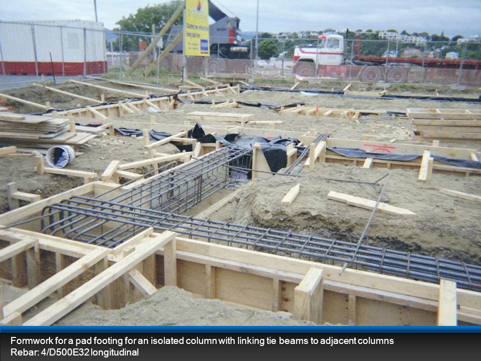 Formwork for a pad footing for an isolated column with linking tie beams to adjacent columns Rebar: 4/D500E32 longitudinal