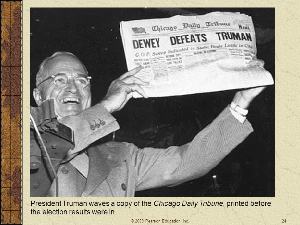 President Truman waves a copy of the Chicago Daily Tribune, printed before the election results were in.
