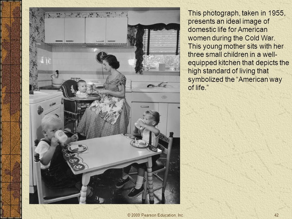 This photograph, taken in 1955, presents an ideal image of domestic life for American women during the Cold War. This young mother sits with her three small children in a well-equipped kitchen that depicts the high standard of living that symbolized the American way of life.