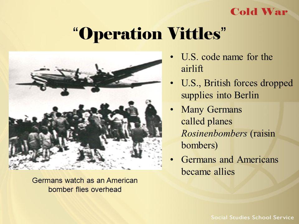 Germans watch as an American bomber flies overhead
