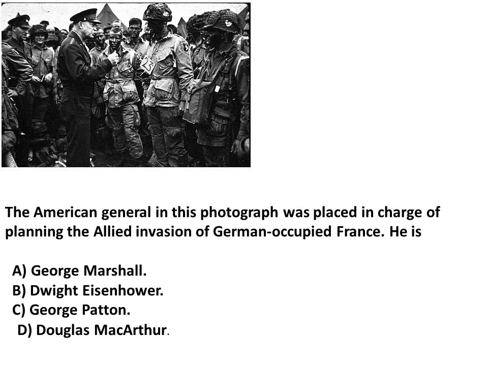 The American general in this photograph was placed in charge of planning the Allied invasion of German-occupied France. He is