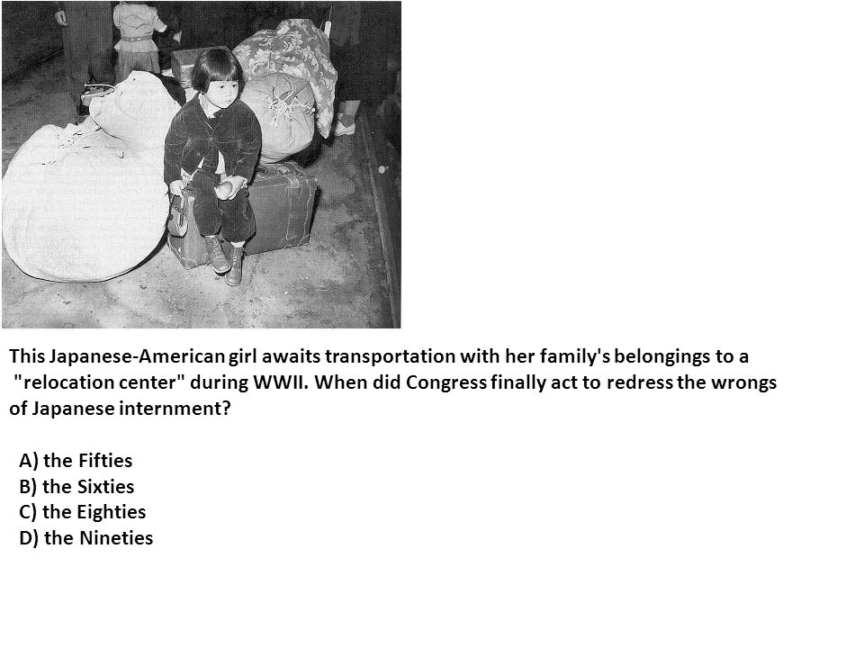 This Japanese-American girl awaits transportation with her family s belongings to a