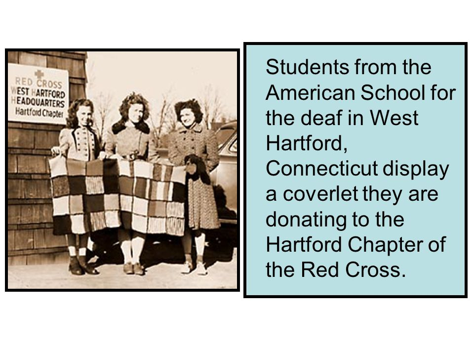 Students from the American School for the deaf in West Hartford, Connecticut display a coverlet they are donating to the Hartford Chapter of the Red Cross.