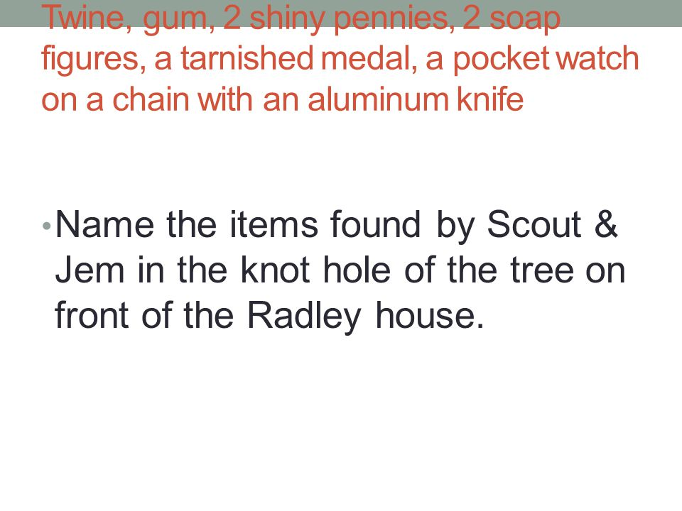 Twine, gum, 2 shiny pennies, 2 soap figures, a tarnished medal, a pocket watch on a chain with an aluminum knife