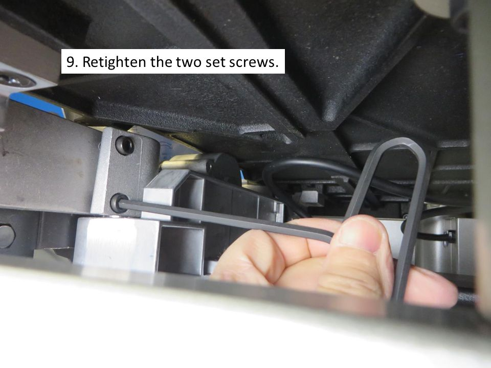 9. Retighten the two set screws.