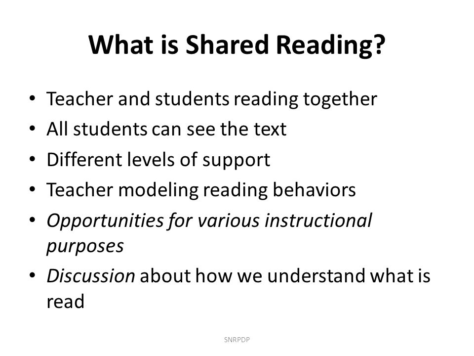 What is Shared Reading Teacher and students reading together