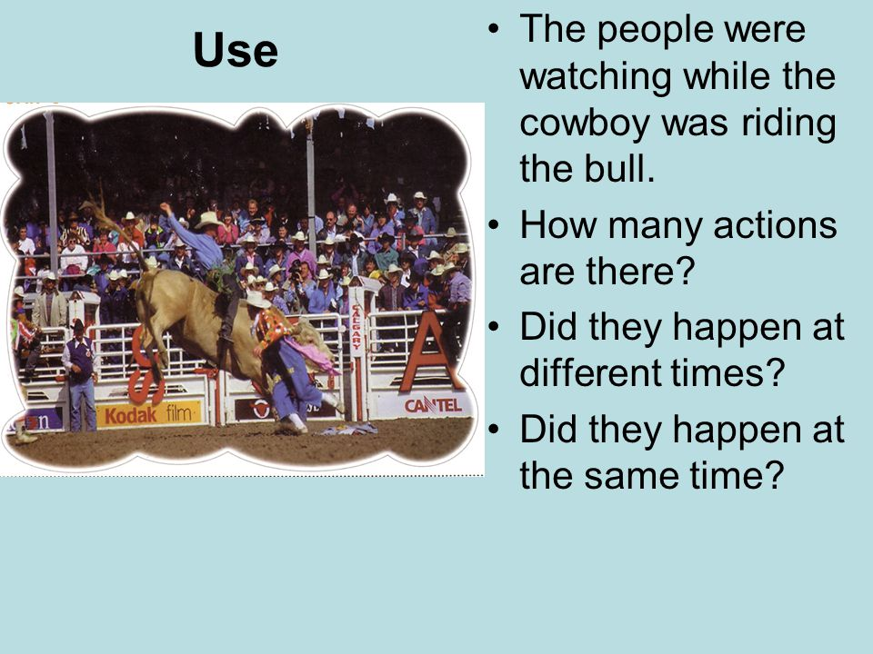 Use The people were watching while the cowboy was riding the bull.