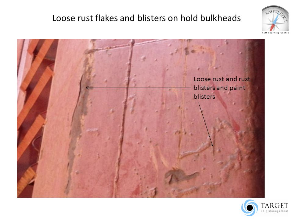 Loose rust flakes and blisters on hold bulkheads
