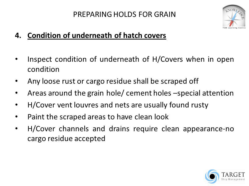 PREPARING HOLDS FOR GRAIN