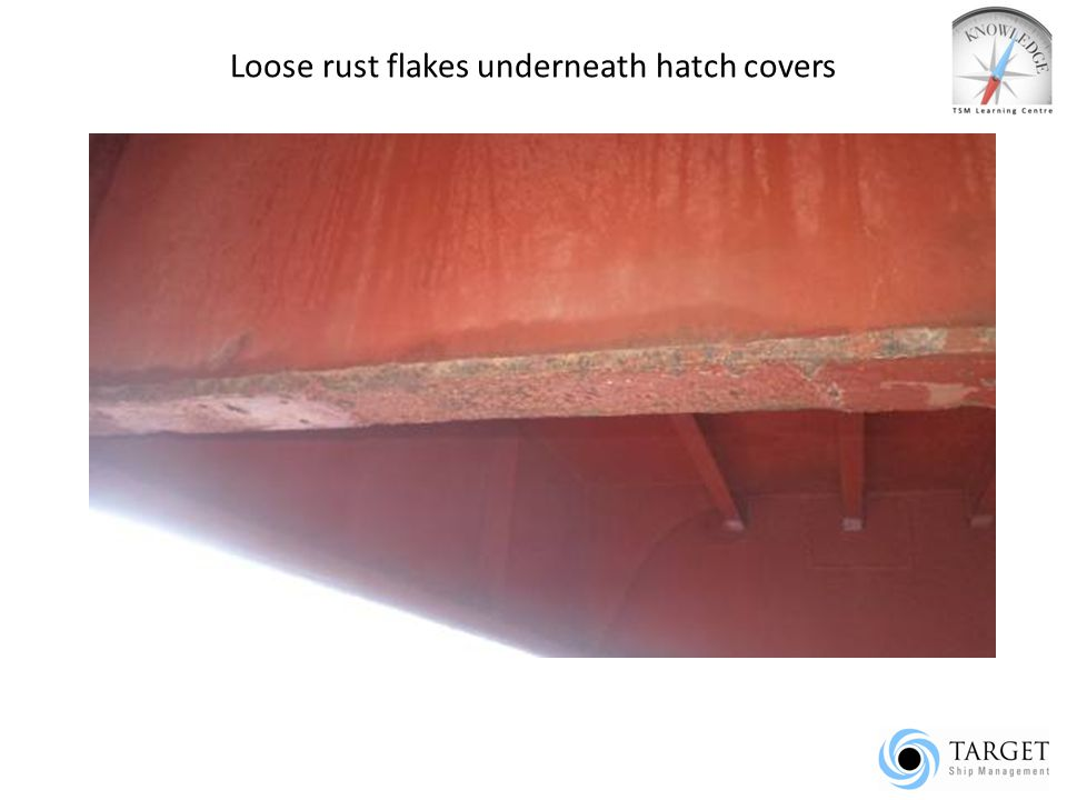 Loose rust flakes underneath hatch covers