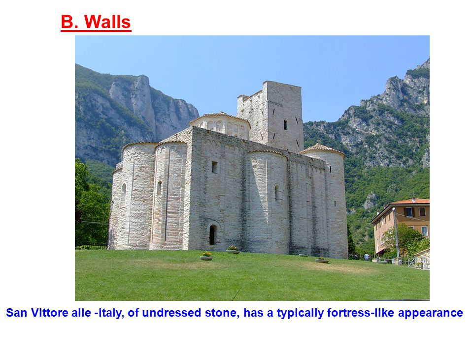B. Walls San Vittore alle -Italy, of undressed stone, has a typically fortress-like appearance