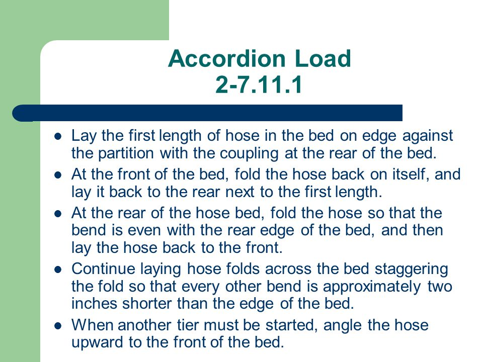 Accordion Load 2-7.11.1 Lay the first length of hose in the bed on edge against the partition with the coupling at the rear of the bed.