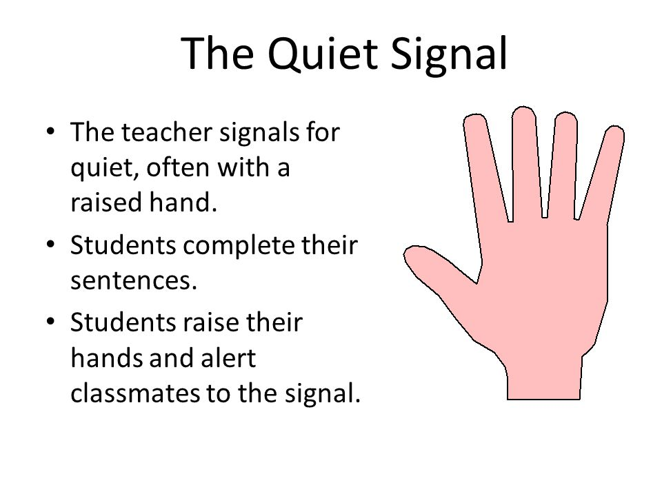 The Quiet Signal The teacher signals for quiet, often with a raised hand. Students complete their sentences.
