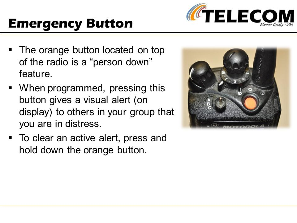 Emergency Button The orange button located on top of the radio is a person down feature.