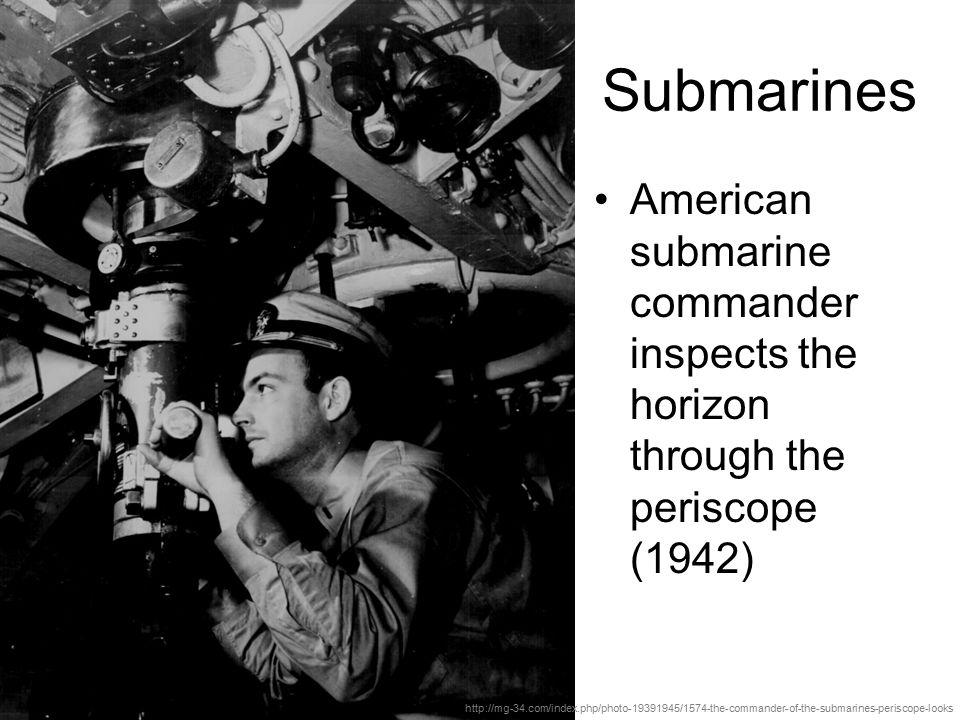 Submarines American submarine commander inspects the horizon through the periscope (1942)