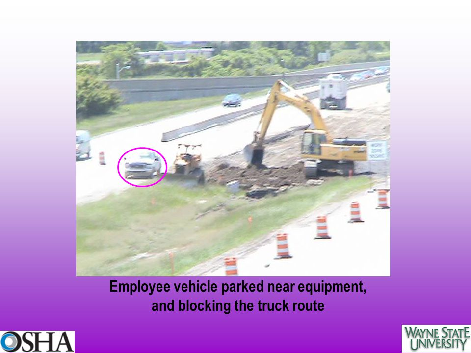 Employee vehicle parked near equipment, and blocking the truck route