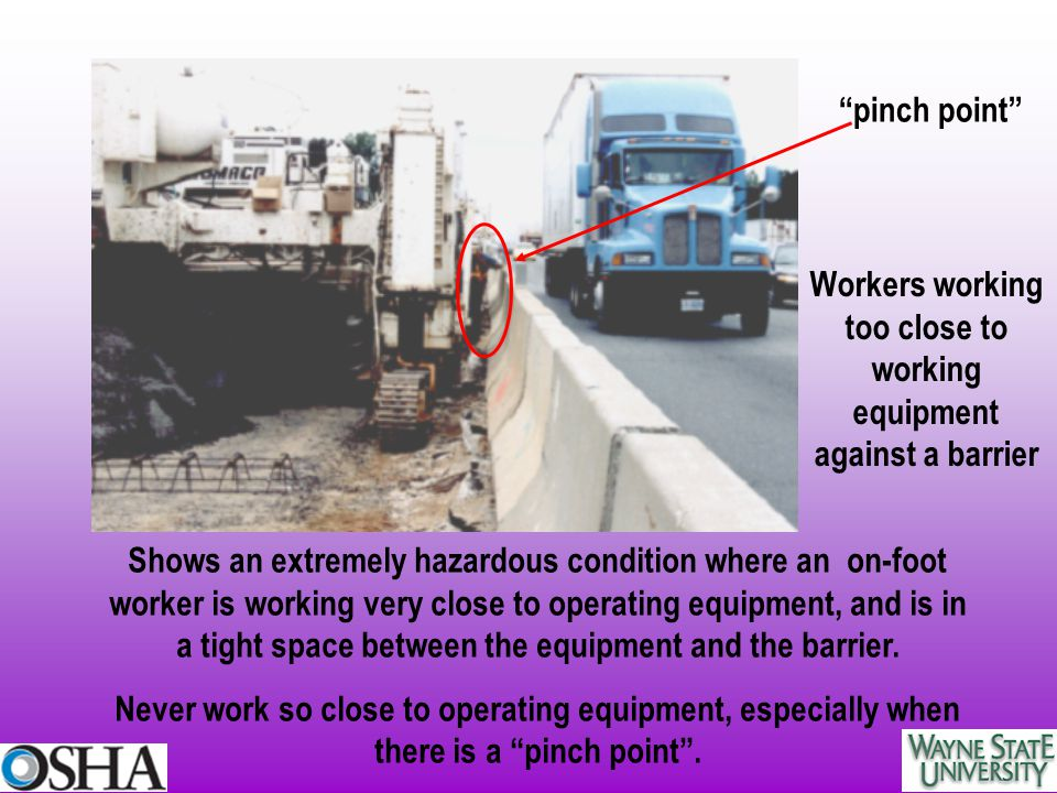 Workers working too close to working equipment against a barrier