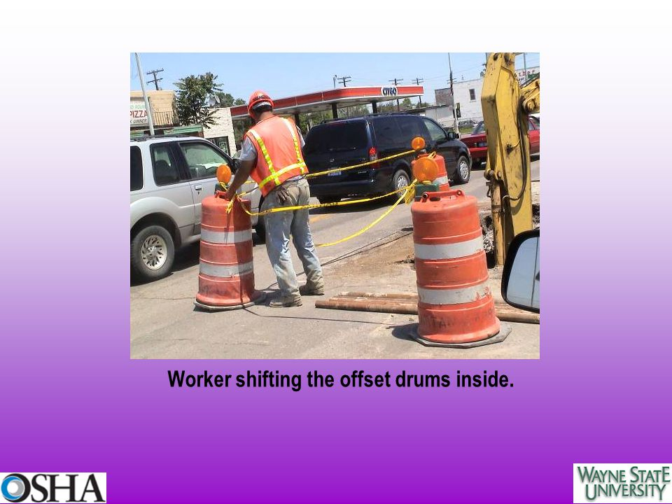 Worker shifting the offset drums inside.