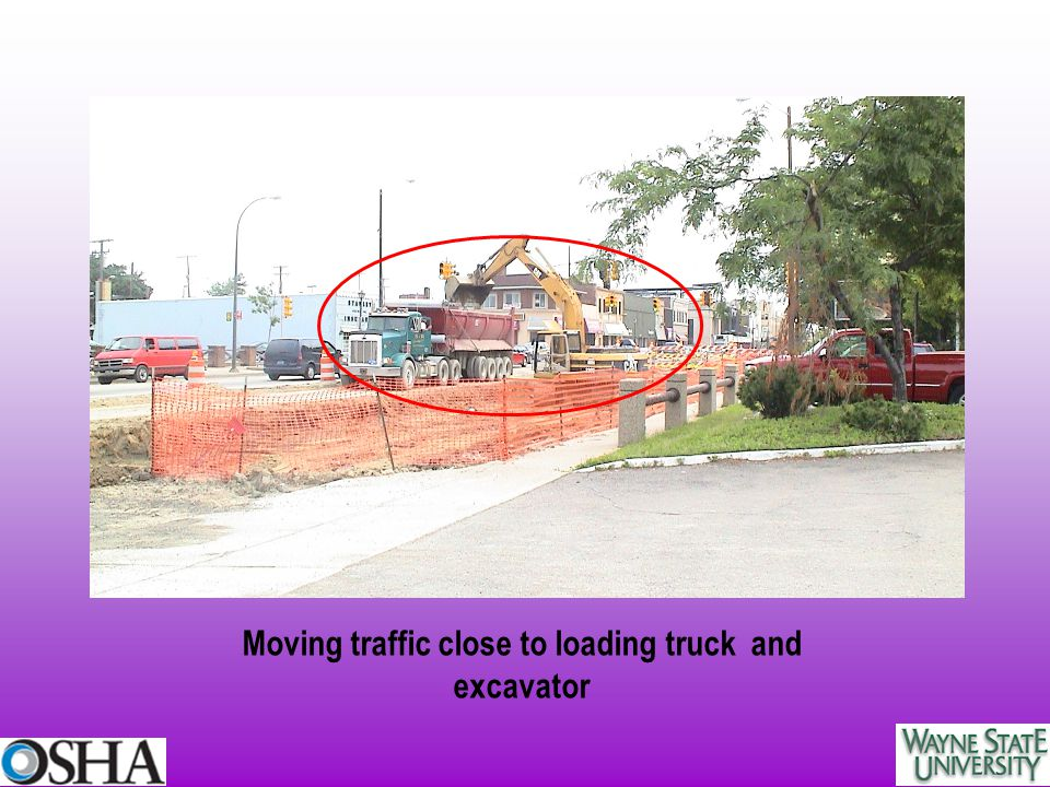 Moving traffic close to loading truck and excavator