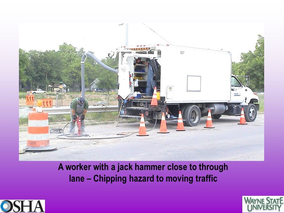 A worker with a jack hammer close to through lane – Chipping hazard to moving traffic