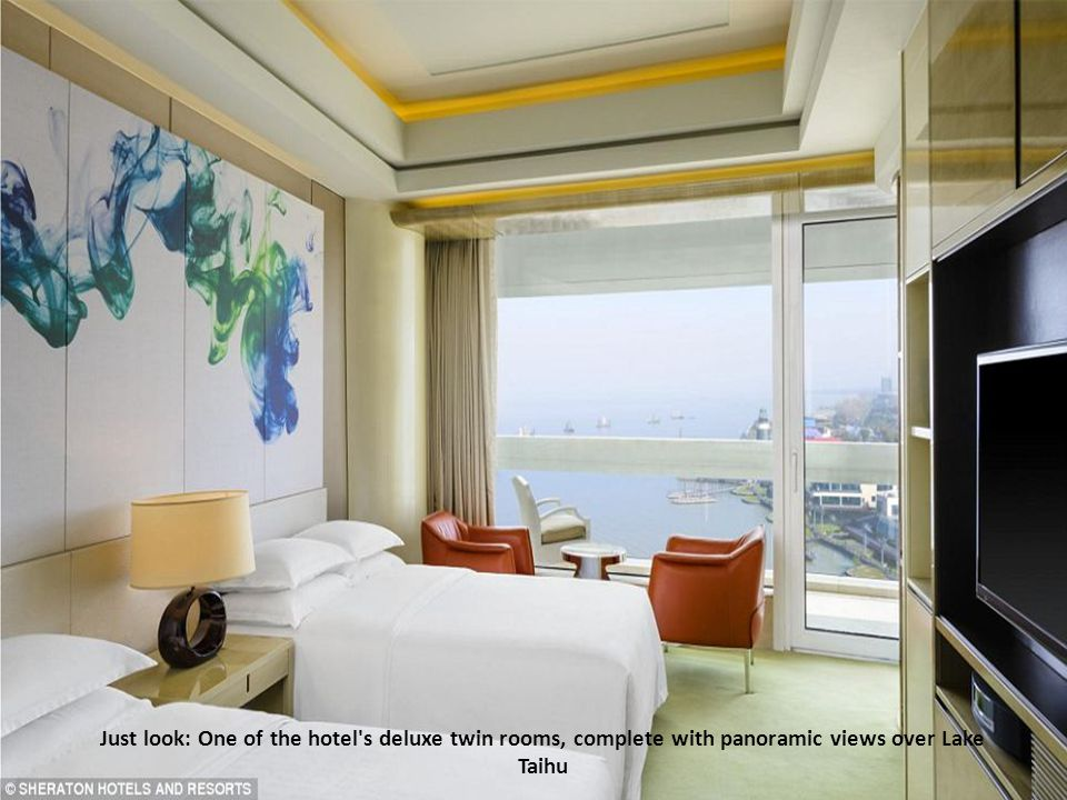 Just look: One of the hotel s deluxe twin rooms, complete with panoramic views over Lake Taihu
