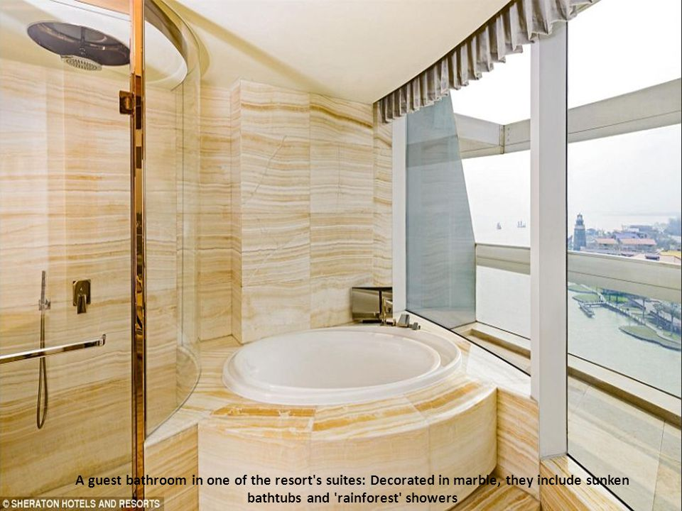 A guest bathroom in one of the resort s suites: Decorated in marble, they include sunken bathtubs and rainforest showers
