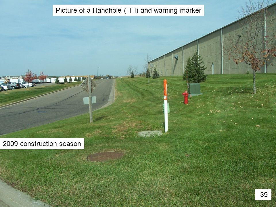 Picture of a Handhole (HH) and warning marker