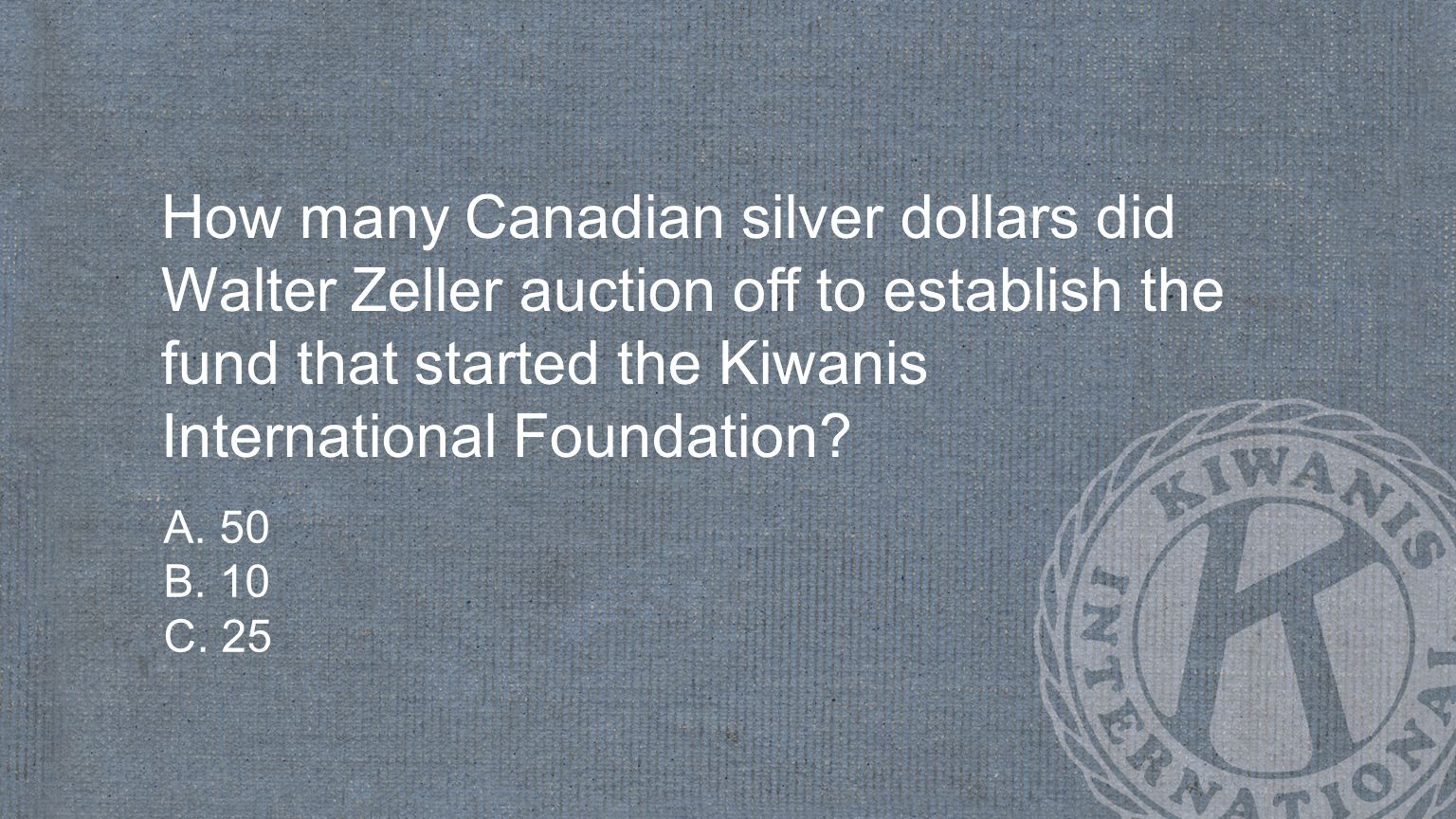 How many Canadian silver dollars did Walter Zeller auction off to establish the fund that started the Kiwanis International Foundation