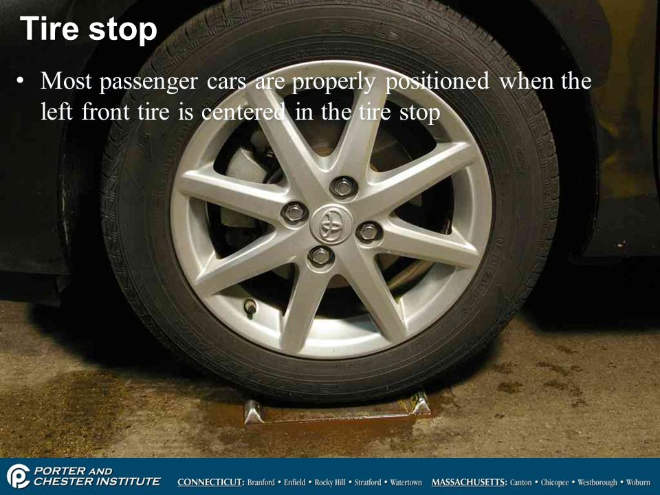 Tire stop Most passenger cars are properly positioned when the left front tire is centered in the tire stop.