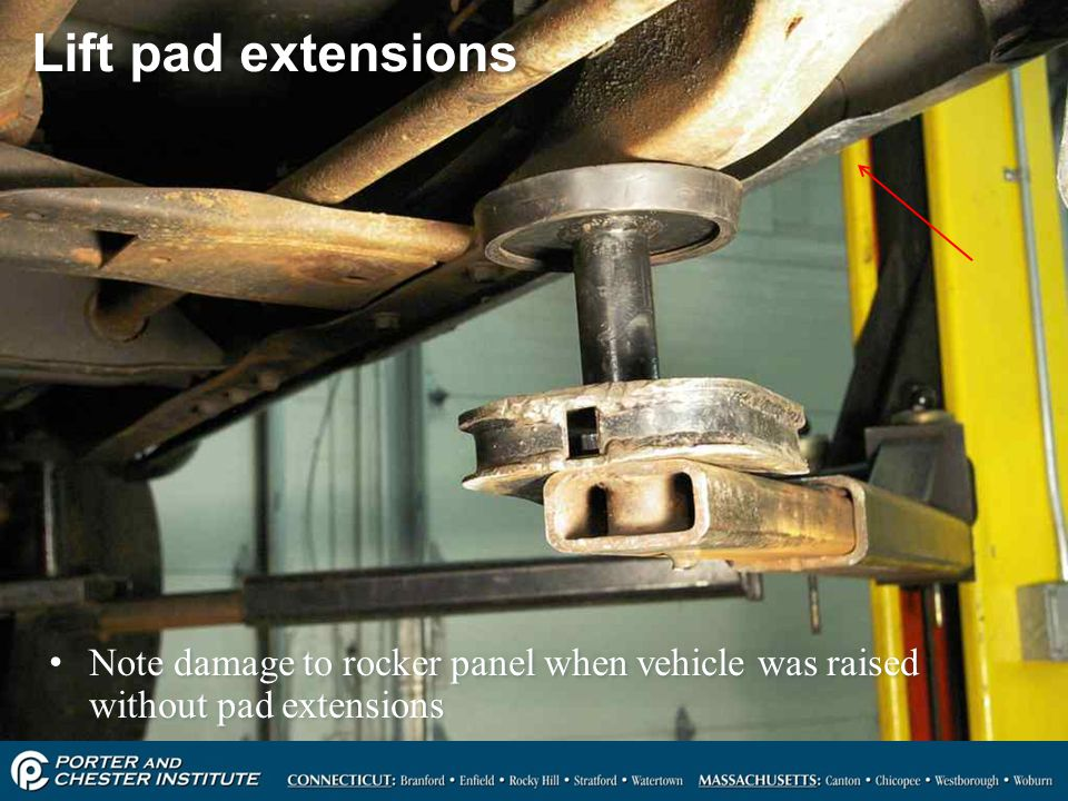 Lift pad extensions Note damage to rocker panel when vehicle was raised without pad extensions