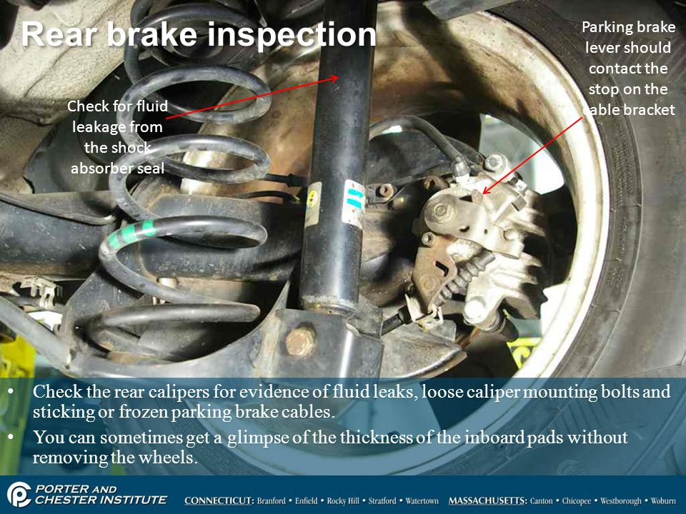 Rear brake inspection Parking brake lever should contact the stop on the cable bracket. Check for fluid leakage from the shock absorber seal.