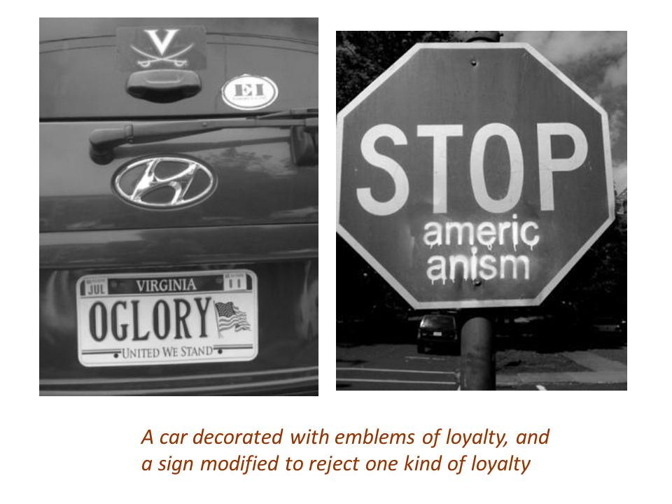 A car decorated with emblems of loyalty, and a sign modified to reject one kind of loyalty