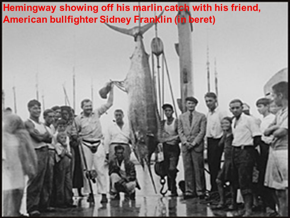 Hemingway showing off his marlin catch with his friend, American bullfighter Sidney Franklin (in beret)