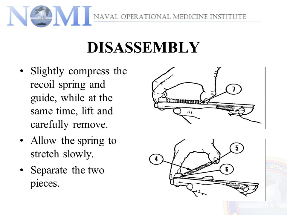 DISASSEMBLY Slightly compress the recoil spring and guide, while at the same time, lift and carefully remove.