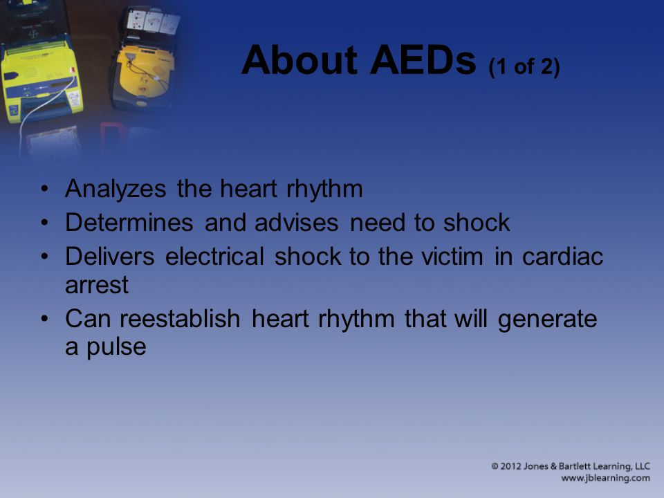About AEDs (1 of 2) Analyzes the heart rhythm