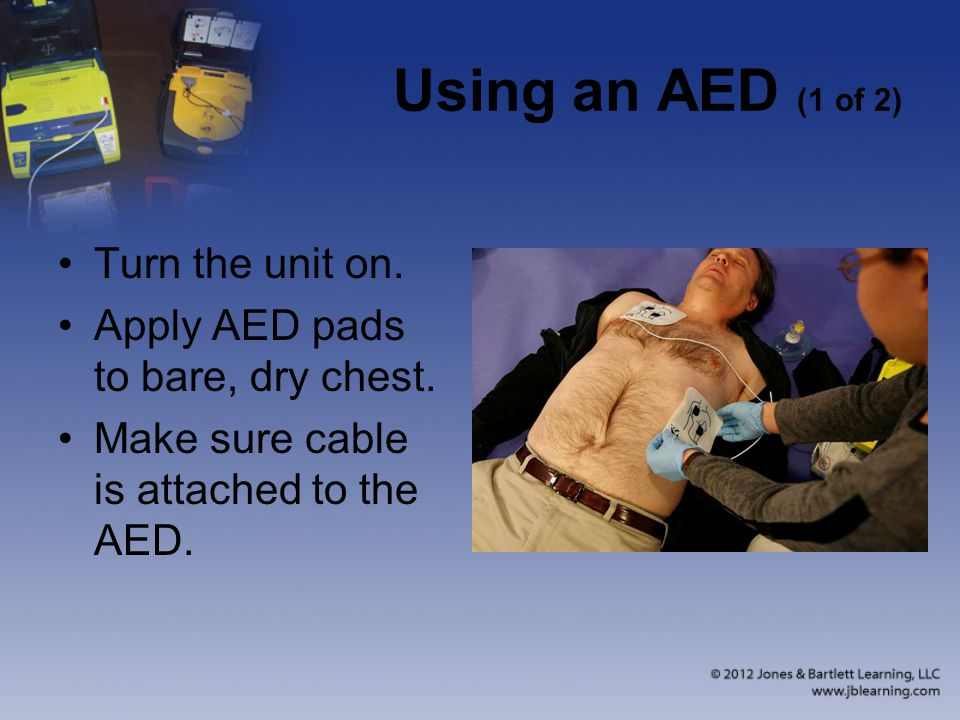 Using an AED (1 of 2) Turn the unit on.