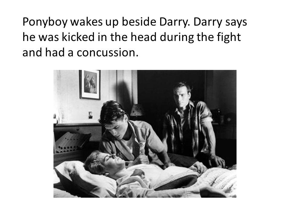 Ponyboy wakes up beside Darry