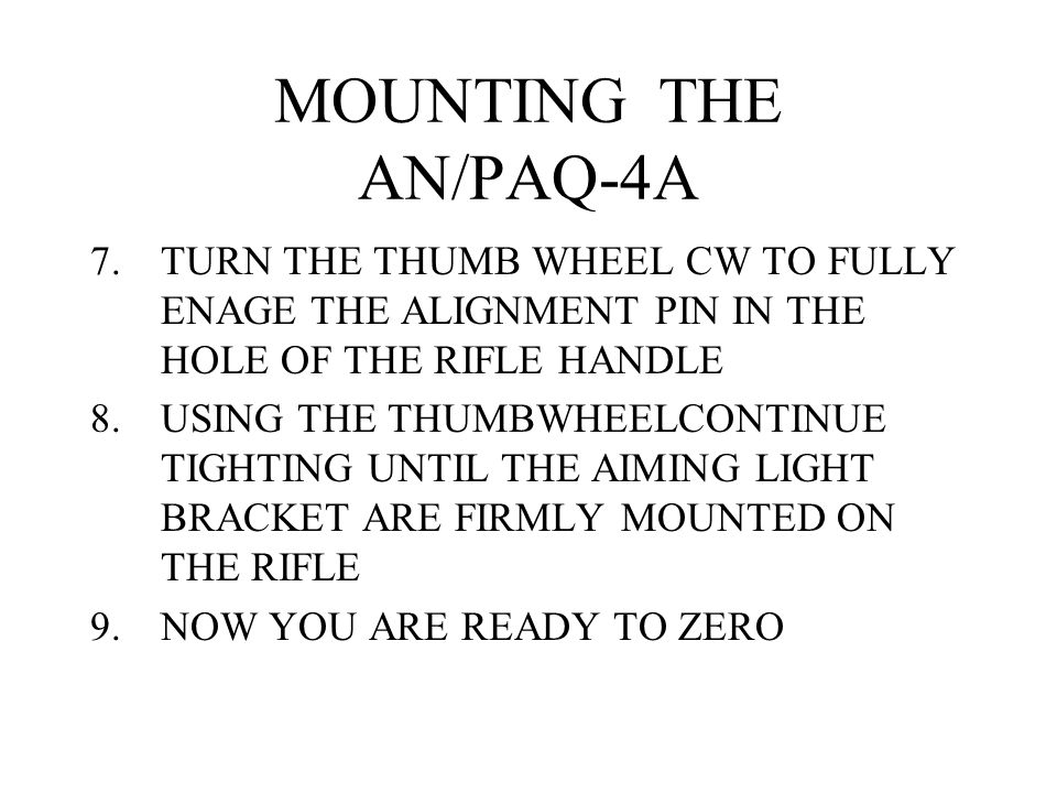 MOUNTING THE AN/PAQ-4A TURN THE THUMB WHEEL CW TO FULLY ENAGE THE ALIGNMENT PIN IN THE HOLE OF THE RIFLE HANDLE.