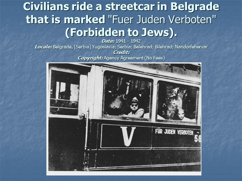 Civilians ride a streetcar in Belgrade that is marked Fuer Juden Verboten (Forbidden to Jews).