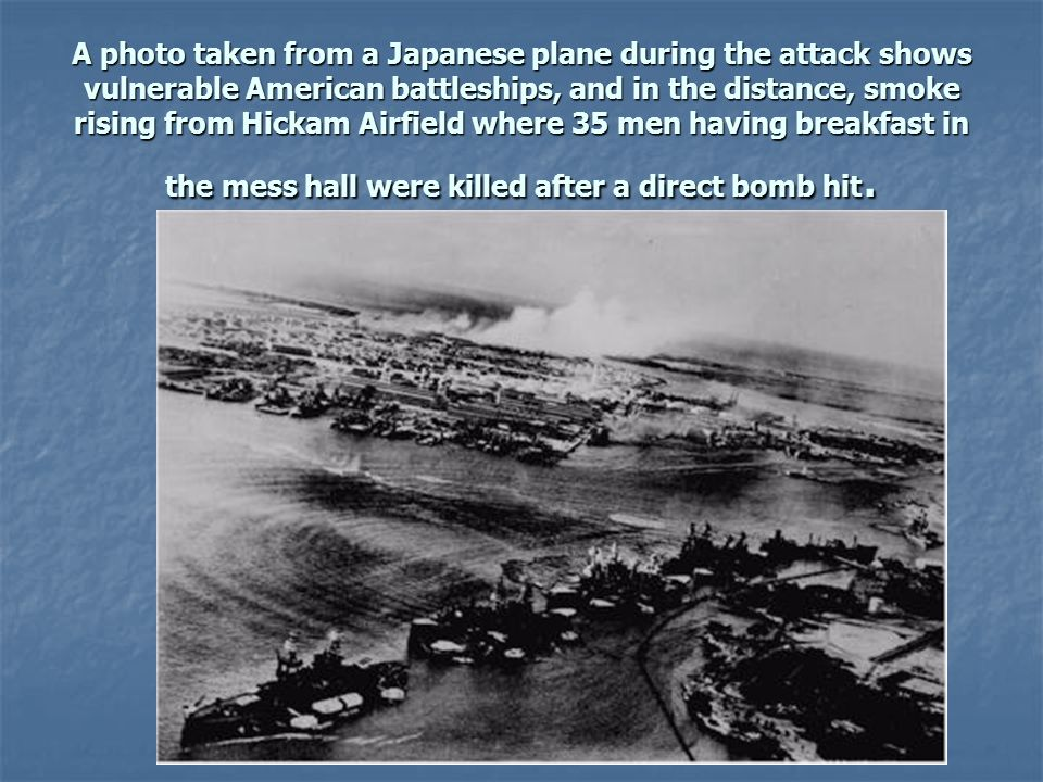 A photo taken from a Japanese plane during the attack shows vulnerable American battleships, and in the distance, smoke rising from Hickam Airfield where 35 men having breakfast in the mess hall were killed after a direct bomb hit.