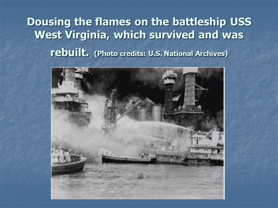 Dousing the flames on the battleship USS West Virginia, which survived and was rebuilt.