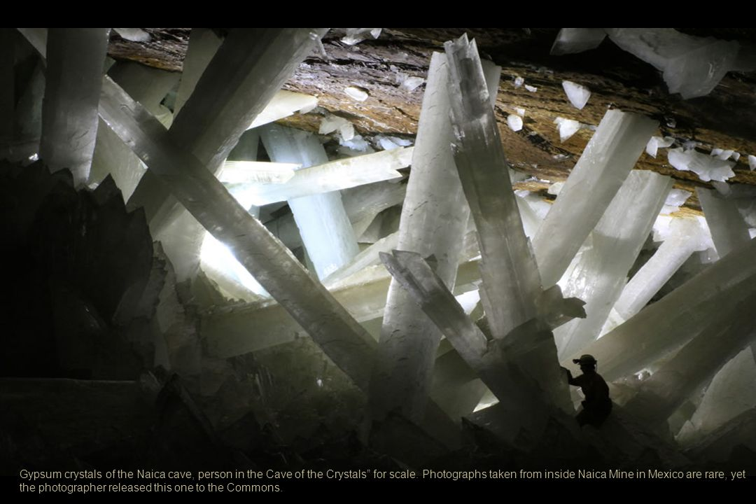 Gypsum crystals of the Naica cave, person in the Cave of the Crystals for scale.